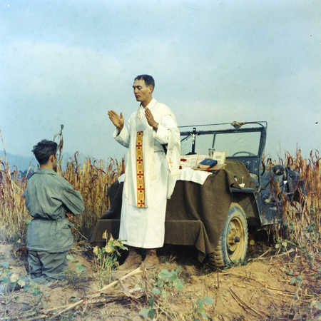 Chaplain Kapaun conducts mass in October 1950.