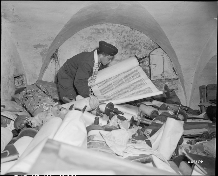 Chaplain Samuel Blinder examines hundreds of Torahs stolen occupied territories.